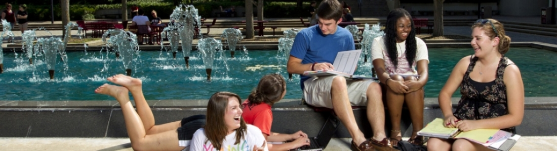Student at a study session around a fountain