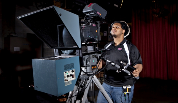 Student operating a video camera