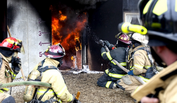 Firefighters putting out a blazing fire