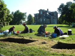 A number of students at Archaeological dig at White Hall State Historic Site