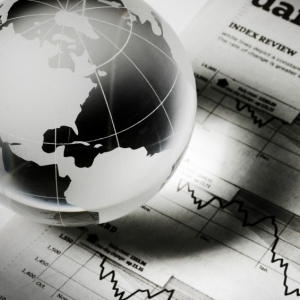 Glass globe atop business reports