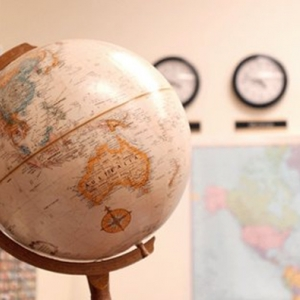 Globe and map of the world in classroom